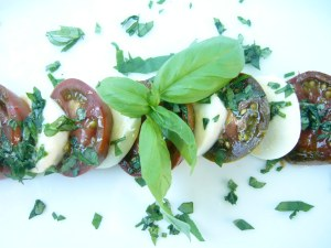 """Layered"" Caprese Salad (made with heirloom tomatoes - they look green but are actually ripe)"