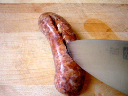 1. Slice the sausage lengthwise down the middle, making sure to pierce the skin but not cutting all the way through the sausage