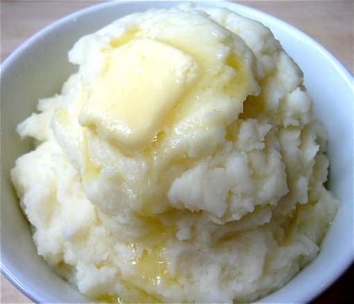 Creamy mashed potatoes with a pat of butter