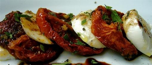 Roasted tomatoes, oregano and balsamic vinegar make a caprese salad ...