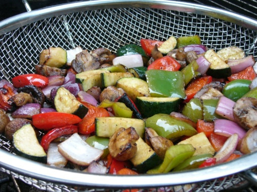A mesh grill pan keeps cut up vegetables from falling through the grate