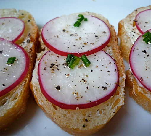 A simple appetizer of sliced radishes on bread with butter and sea salt is classic and delicious