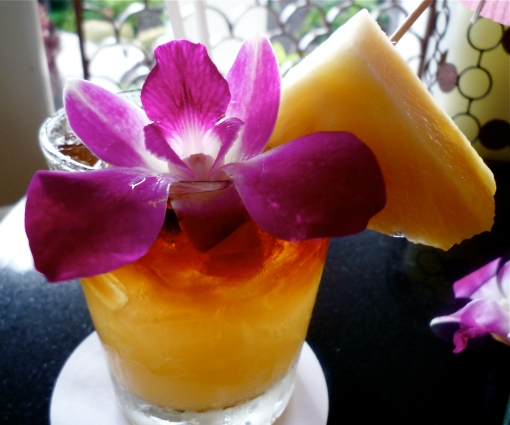 A mai tai cocktail, garnished with a Hawaiian orchid
