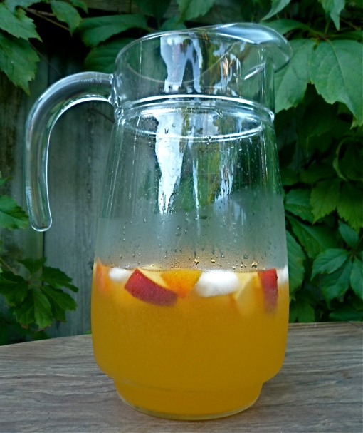 Ice cold peach sangria - the perfect refreshment on a hot August afternoon