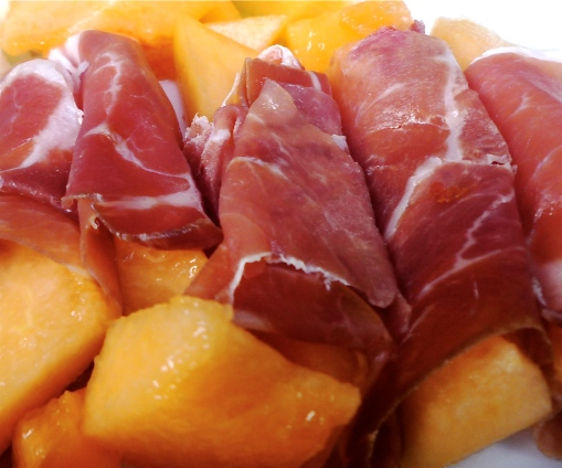 Melon wrapped with proscuitto makes a classic hors d'oeuvre